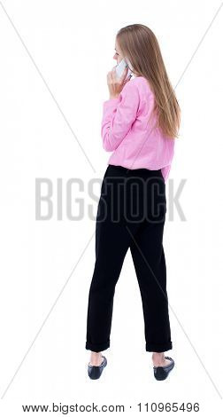 back view of a woman talking on the phone.  backside view of person.  Rear view people collection. Isolated over white background. Turning left the girl on the phone.