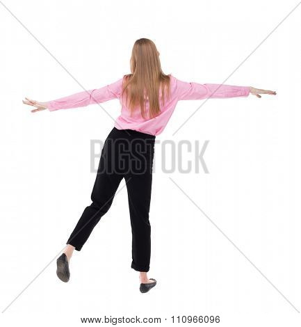 Balancing young business woman.  or dodge falling woman. Rear view people collection.  Isolated over white background. The girl office worker in black pants balances on the left leg.