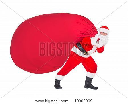 Santa Claus Pull Christmas Bag With Gifts Isolated On White