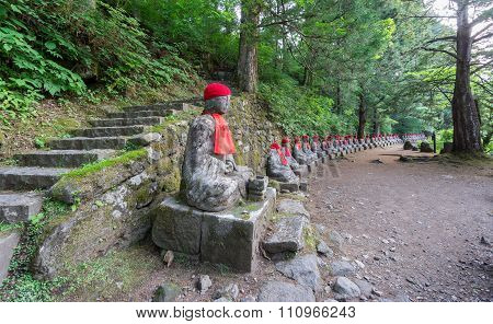 Wide angle of statues and track in Nikko