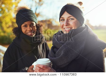 Two Girlfriends Looking At Camera And Smiling