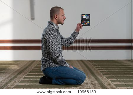 Casual Man Showing Color Checker