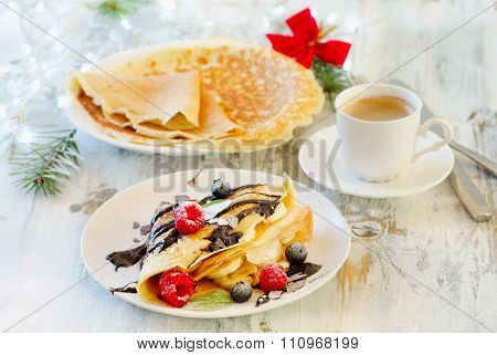 Christmas Breakfast. Cup Of Coffee And Crepes With Fresh Berries.