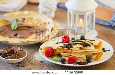 Christmas Breakfast. Crepes With Chocolate Cream And Berries.