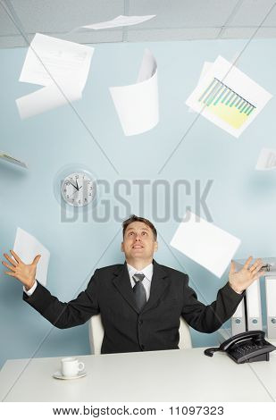 Bureaucrat -  Businessman Juggling Documents