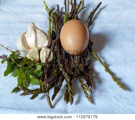Ingredients on white background for a frittata with asparagus