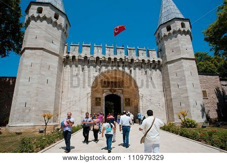 People With Children Walking Through The Gate Of Historical Topkapi Palace, Turkey