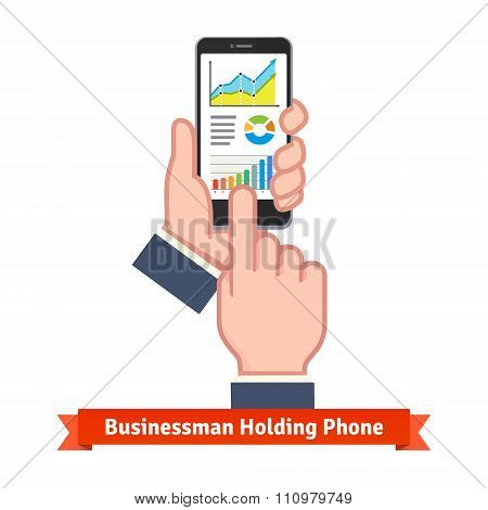 Business man hands holding phone and scrolling