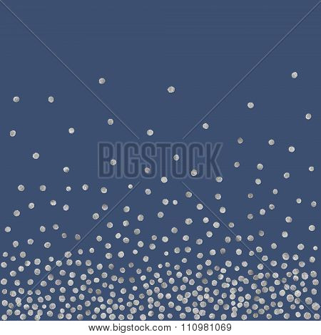 Abstract pattern of random silver dots.