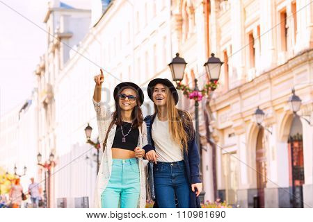 Two young women walking together and admiring