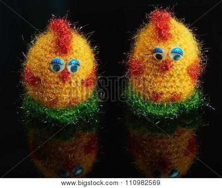 Two Chicken Crocheting On A Dark Background