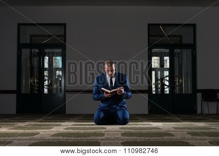 Muslim Businessman Is Reading The Koran