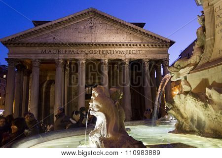 Fontana Del Pantheon In Rome, With The Temple