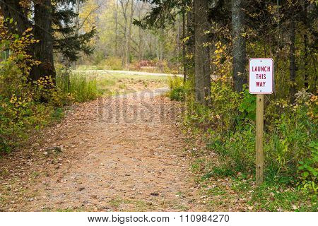 Launch Sign Next To Winding Path