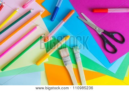 Set Of Different Colors Felt-tip Pens, Pencils, Brushes And Colored Paper