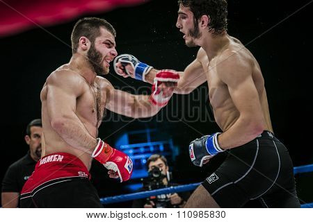 athlete mixed martial arts fighter gets cross hand to his opponent
