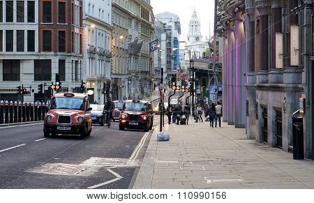 Taxis and Cyclist on a London Street