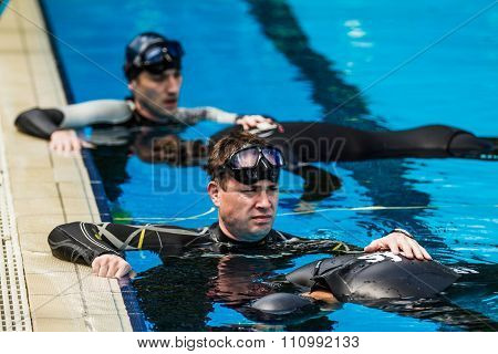 Freediver Doing Static Performance With Coach A Coach Doing The Safety.