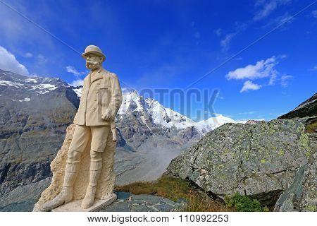 GROSSGLOCKNER, AUSTRIA - SEPTEMBER 2014 : Statue of Kaiser Franz Joseph I with the view of Grossglockner mountain range in the background at Grossglockner, Austria on September 16, 2014.