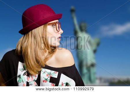 Girl in hipster glasses and hat on New York background