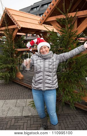 Attractive Woman On The Christmas Market With Warm Drink