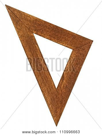 vintage wooden stained triangle ruler over white