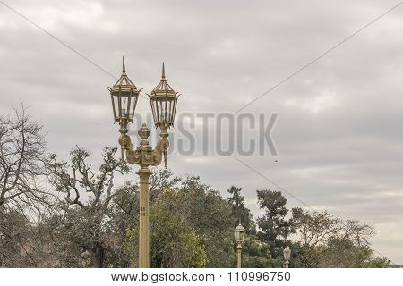 Antique City Lights And Nature At Recoleta Park In Buenos Aires