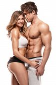Sexy Couple, Muscular Man Holding A Beautiful Woman poster