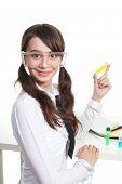 stock photo of teen pony tail  - Happy teenage girl study chemistry holding a test tube - JPG