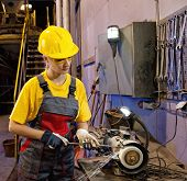 picture of factory-worker  - Factory attractive female worker sharpening a tools - JPG