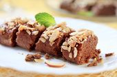 stock photo of lenten  - Lenten almond cake sprinkled with chopped nuts - JPG