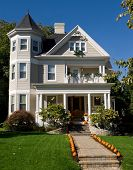 image of victorian houses  - Vintage Victorian house decorated with orange pumpkins for fall - JPG