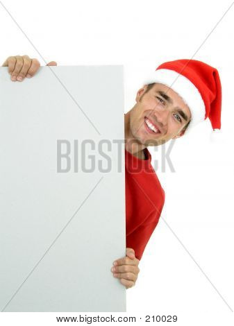 Young, Handsome Santa Holding A White Card