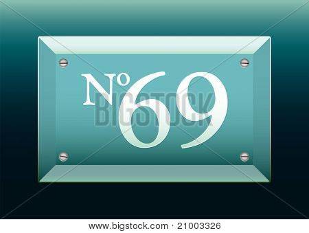 Green glass number sign with black background and 69
