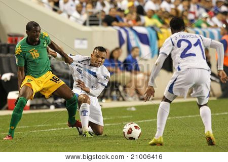 HARRISON, NJ - JUNE 13: Honduras player Emil Martinez (7) and Jamaica's Omar Daley (16) battle for the ball during the first half of the 2011 CONCACAF Gold Cup on June 13, 2011 at Red Bulls Arena in Harrison, NJ at Red Bulls Arena. Jamaica won 1-0.