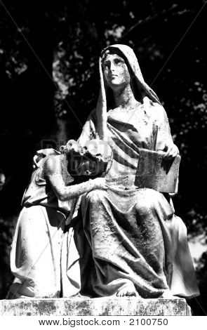 A Black And White Gravemarker Of A Woman And Child