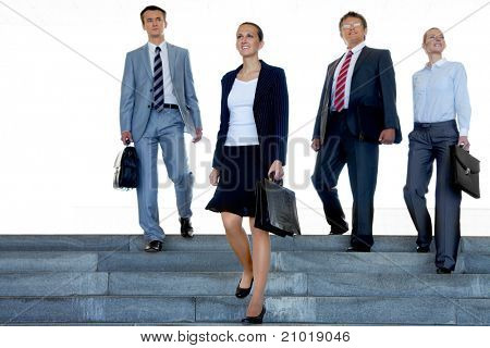 Portrait of confident business partners walking down stairs outdoors