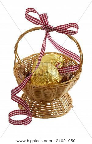 Chocolate Eggs Wrapped  Golden Foil In Easter Basket