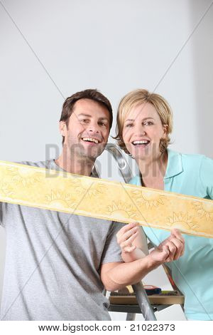 Couple holding colorful wallpaper border