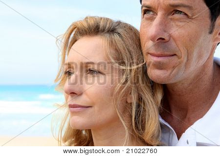 Head shot of couple by sea