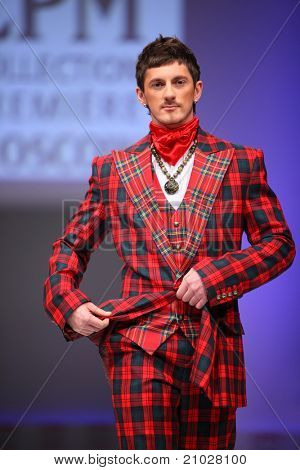 MOSCOW - FEBRUARY 22: A model wears a checkered suit from Slava Zaytzev and walks catwalk in the Collection Premiere Moscow, leading fashion fair in Eastern European market, on February 22, 2011 in Moscow, Russia