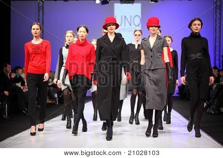 MOSCOW - FEBRUARY 22: Models wear fashions by UNQ and walk the catwalk in the Collection Premiere Moscow, an international fashion fair for Eastern Europe, on February 22, 2011 in Moscow, Russia.