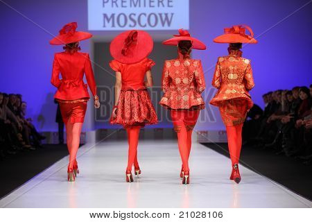 MOSCOW - FEBRUARY 22: Models show the backs of four suits from Slava Zaytzev and walk catwalk in Collection Premiere Moscow, fashion industry platform of IGEDO Company, on February 22, 2011 in Moscow, Russia.