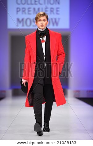 MOSCOW - FEBRUARY 22: A model wears a red coat from Slava Zaytzev and walks the catwalk in the Collection Premiere Moscow, leading fashion fair in Eastern European market, on February 22, 2011 in Moscow, Russia.