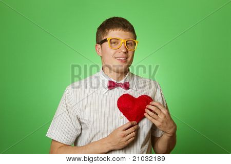 Smiling guy holding heart shape