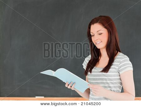 Smiling Woman Reading Her Notes