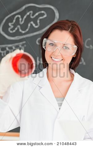 Smiling Red-haired Scientist Looking At A Petri Dish
