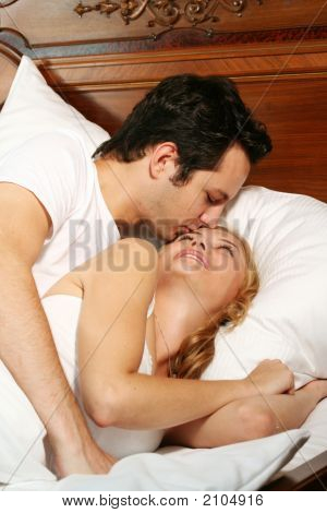 Kissing Couple In Bed