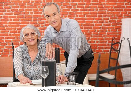 Couple posing in a restaurant