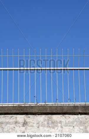 Fence Against Blue Sky